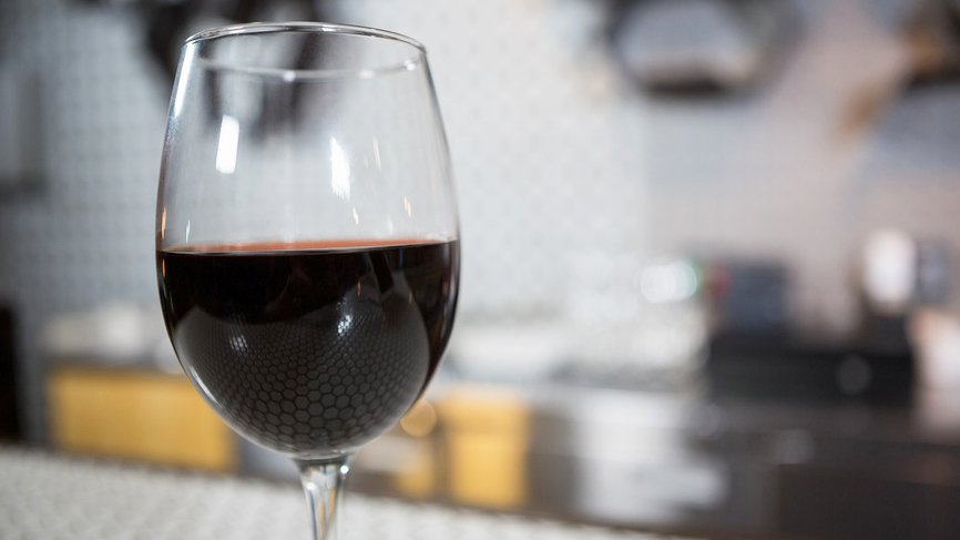 Glass of red wine on counter