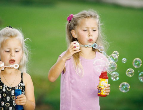 girls make soap bubbles