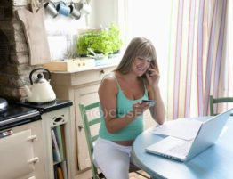 focused_33994589-stock-photo-pregnant-woman-with-laptop