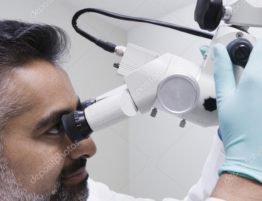 depositphotos_21977869-stock-photo-asian-male-dentist-with-microscope